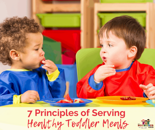 Two toddlers eating lunch together. Learn the 7 Principles of Serving Healthy Toddler Meals.